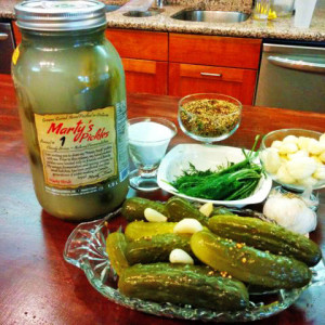 Marty's Pickles in a jar, pickles on a plate